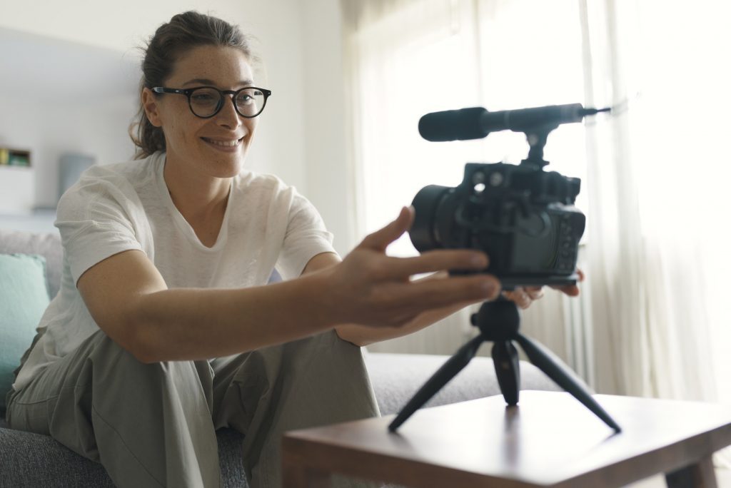 Youtuber recording a video in the living room